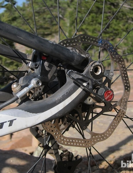 The rear brake is tucked inside the rear triangle. It's a bit tougher to adjust but better protected and allows for thinner seatstays