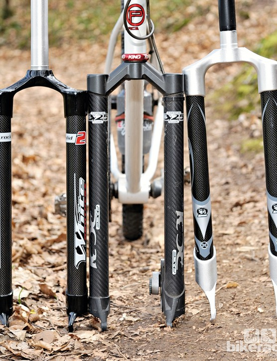 This picture shows the difference in size of rigid forks designed for, from left to right, 26in, 27.5in and 29in wheels