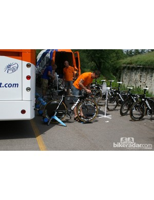 A Rabobank mechanic touches up a Giant