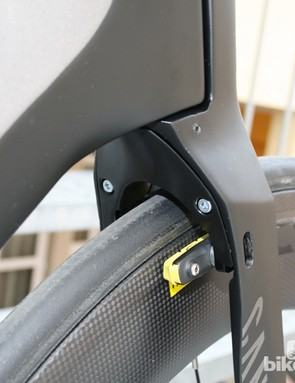The rear mounted front brake fits neatly inside the fork
