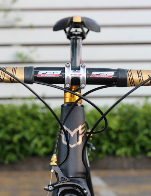 FSA custom-fabricated gold handlebar tape, and gold stem cap and spacers