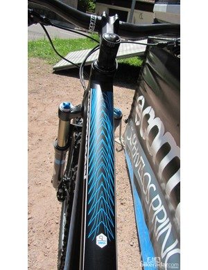 The bright blue graphics stand out on the matt black frame