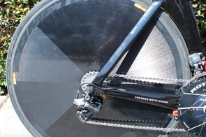 A Mavic Comete disc tucks up right behind the P5's curved seat tube. You can see the red tip of the hydraulic brake caliper protruding from behind the chainring