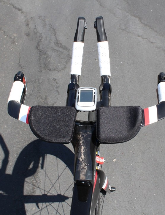 The view from the cockpit — a Garmin 500 is tucked in the area where a bottle cage could also be mounted. Di2 buttons handle the shifting
