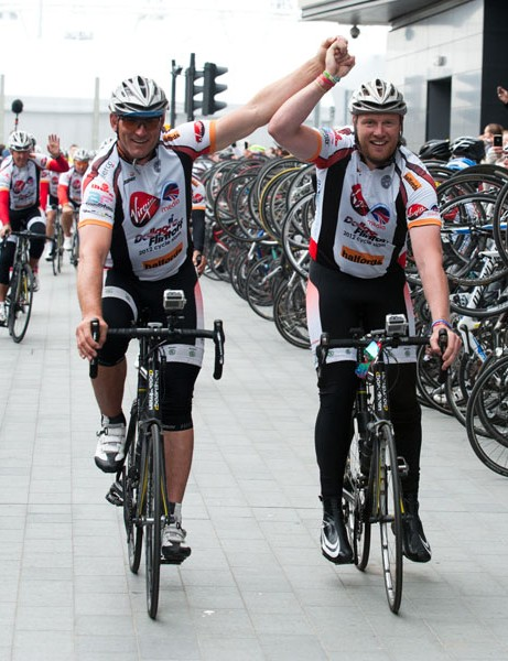 Lawrence Dallaglio and Freddie Flintoff cross the finish line of the Dallaglio Flintoff Cycle Slam 2012, supported by Virgin Media, and Halfords, the Official Cycling Partner. Donate now throughwww.dallaglioflintoff2012.com