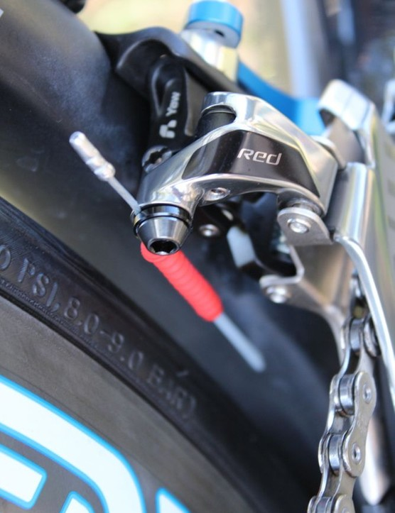 The SRAM Red 2012 front derailleur features a unique pivoting design that eliminates the need for trim settings