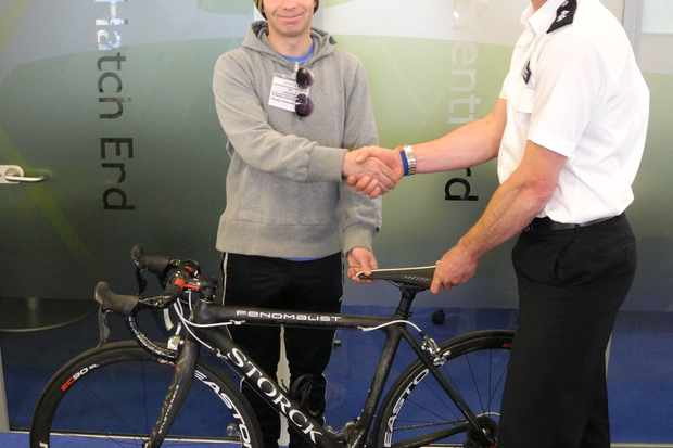 Cycle Task Force Inspector Peter Salter reunites Georg Mew Jensen with the stolen bike