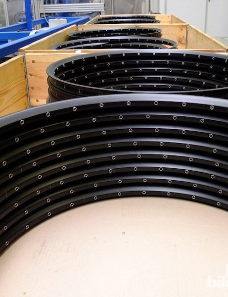 Piles of structurally complete rims ready for finishing