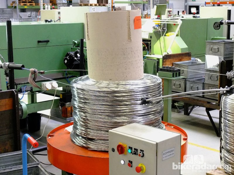 A reel of steel wire in use