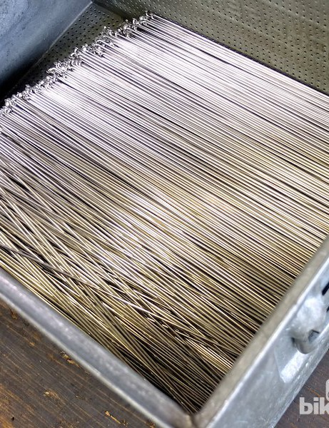 This metal crate of conventional elbowed spokes will go through a giant washing machine for over an hour to remove any grease or dirt