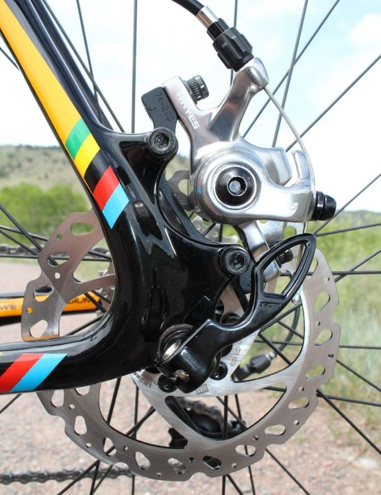 The X-Fire's disc brakes are mechanical, not hydraulic. And a short section of naked cable does pop out below the barrel adjuster