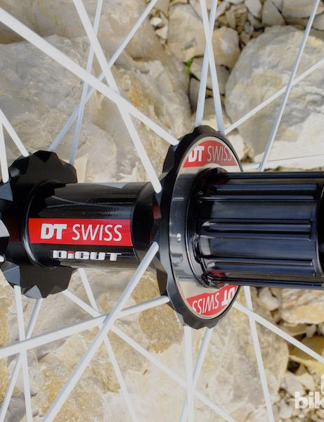 The new DT Swiss Dicut hub with widely spaced flanges, new Nail Head spokes and an 11 speed compatible Shimano freehub body
