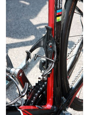 The BMC team's Elite Sior carbon fiber cages feature a small titanium insert molded into the structure to provide a firmer hold on bottles