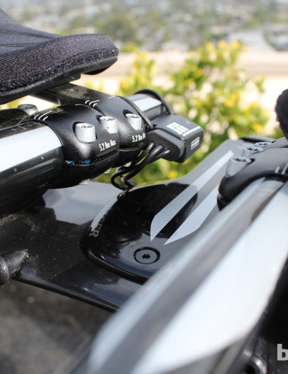 A junction mounted on the right extension connects the wires from the brake-lever and bar-end shifters to the DTI power pack that drives the derailleurs. The junction also serves as a battery-life indicator