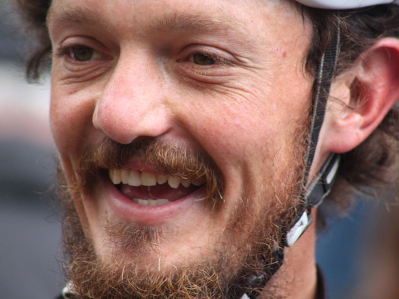 A happy Mike Hall in Greenwich after breaking the round-the-world cycling record