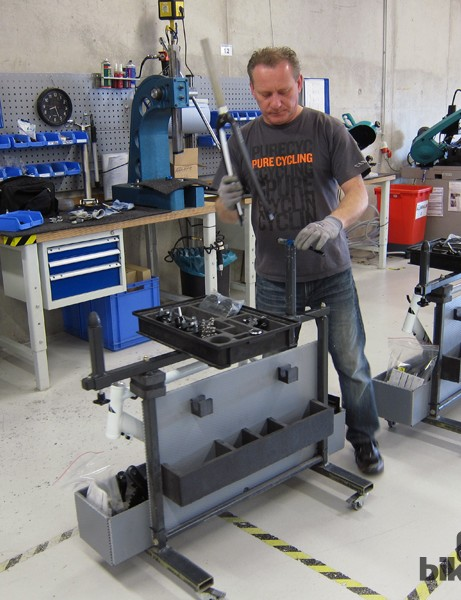 The first step in the assembly process is installing the crown race and mounting the fork onto the work carts