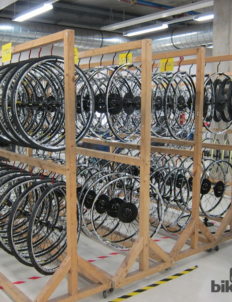 Racks of wheels await inspection and installation