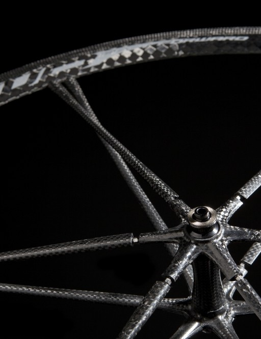 Each spoke contains a nut near the hub that can adjust tension