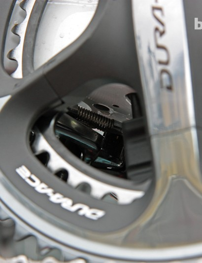 The rear brake on the new Trek Madone incorporates a coil spring behind the arm