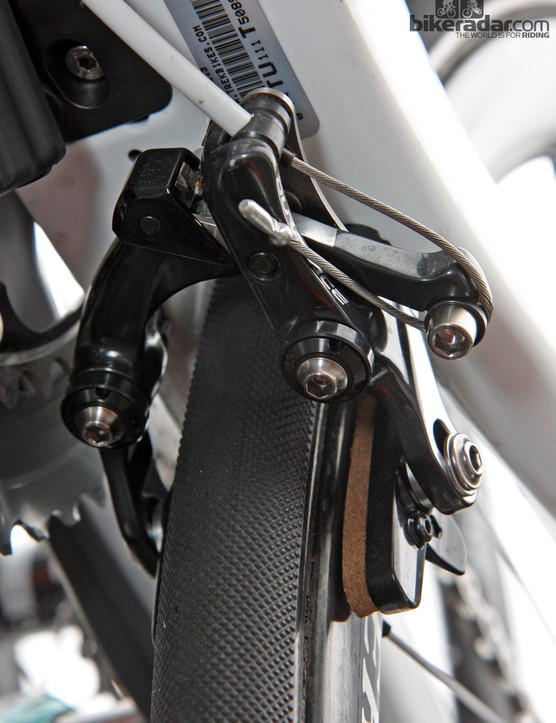 Trek couldn't use a standard Shimano Dura-Ace direct-mount rear brake on the new Madone since the housing would be positioned on the wrong side of the bike. Instead, Shimano provides this more complicated setup with a scissor-style link connecting the two arms. Also note the adjustable pivot bearings, which should allow for perfectly slop-free movement
