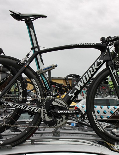 Tony Martin's (Omega Pharma-QuickStep) spare Specialized S-Works Venge sits atop the team car, complete with a new SRAM Red group, Specialized carbon crank, a Zipp aluminum cockpit, and Zipp 303 carbon tubulars wrapped in Specialized's new tires