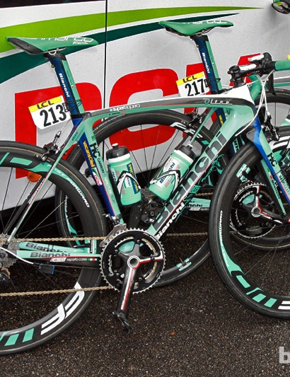 Vacansoleil-DCM's Bianchi Oltres resting against the side of the team bus prior to the start of Stage 5