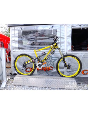 Steve Peat's 2005 Fort William race winning Orange downhill bike is being proudly displayed outside the Orange stand. It looks almost retro by today's standards, but made all that spotted it smile and remember that incredible day's racing
