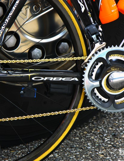 More gold can be found on Samuel Sanchez's (Euskaltel-Euskadi) Orbea Orca in the KMC chain, aluminum derailleur pulleys, and even the accent color on the SRM power meter decal