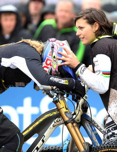 Women's winner Emmeline Ragot commiserates Rachel Atherton, who finished second