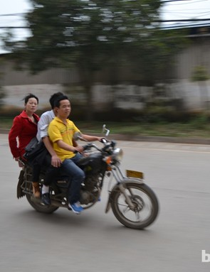 You get odd looks if you wearing Lycra, but three-up and helmetless on a motorcycle is normal