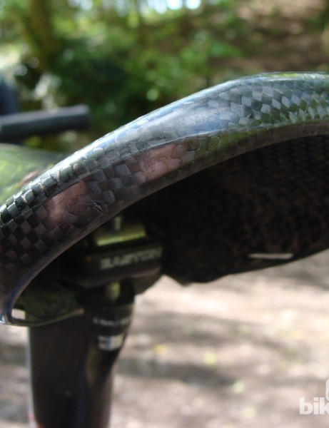 The 60g one-piece saddle is one place the bike saves weight