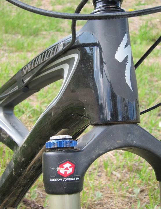 Specialized use a tapered head tube on the Enduro Expert and offer bolt-on guides for a dropper post. We could have used one more boss, as evidenced by the electrical tape