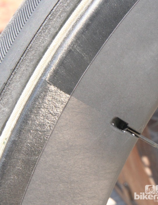 The spoke pockets are part of the rims mould and integral to strength