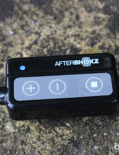 The remote control pad on the AfterShokz headphones