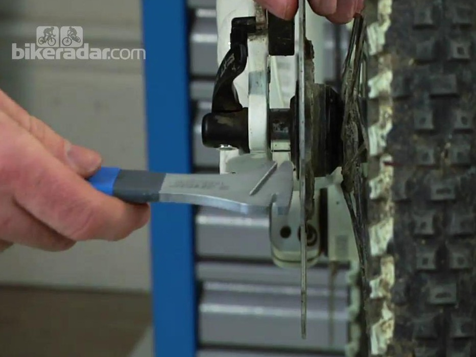 To straighten a disc brake rotor, you can use either this specialist tool or an adjustable wrench