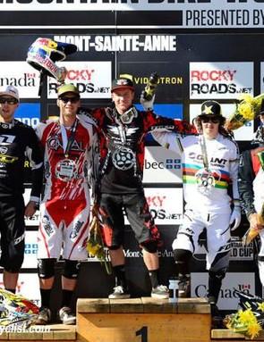 Elite men's downhill World Cup podium in Mont-Sainte-Anne: Gee Atherton (GT), Greg Minnaar (Santa Cruz Syndicate), Aaron Gwin (Trek World Racing), Danny Hart (Giant), Sam Hill (Monster Energy)