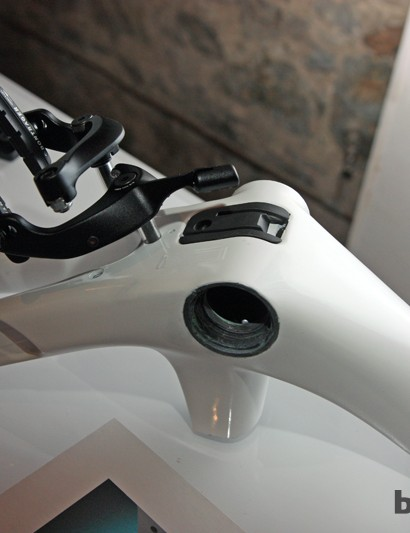 The rear brake on the new Trek Madone 7-Series mounts beneath the chain stays via a new direct mount pattern that reduces weight by eliminating redundant parts