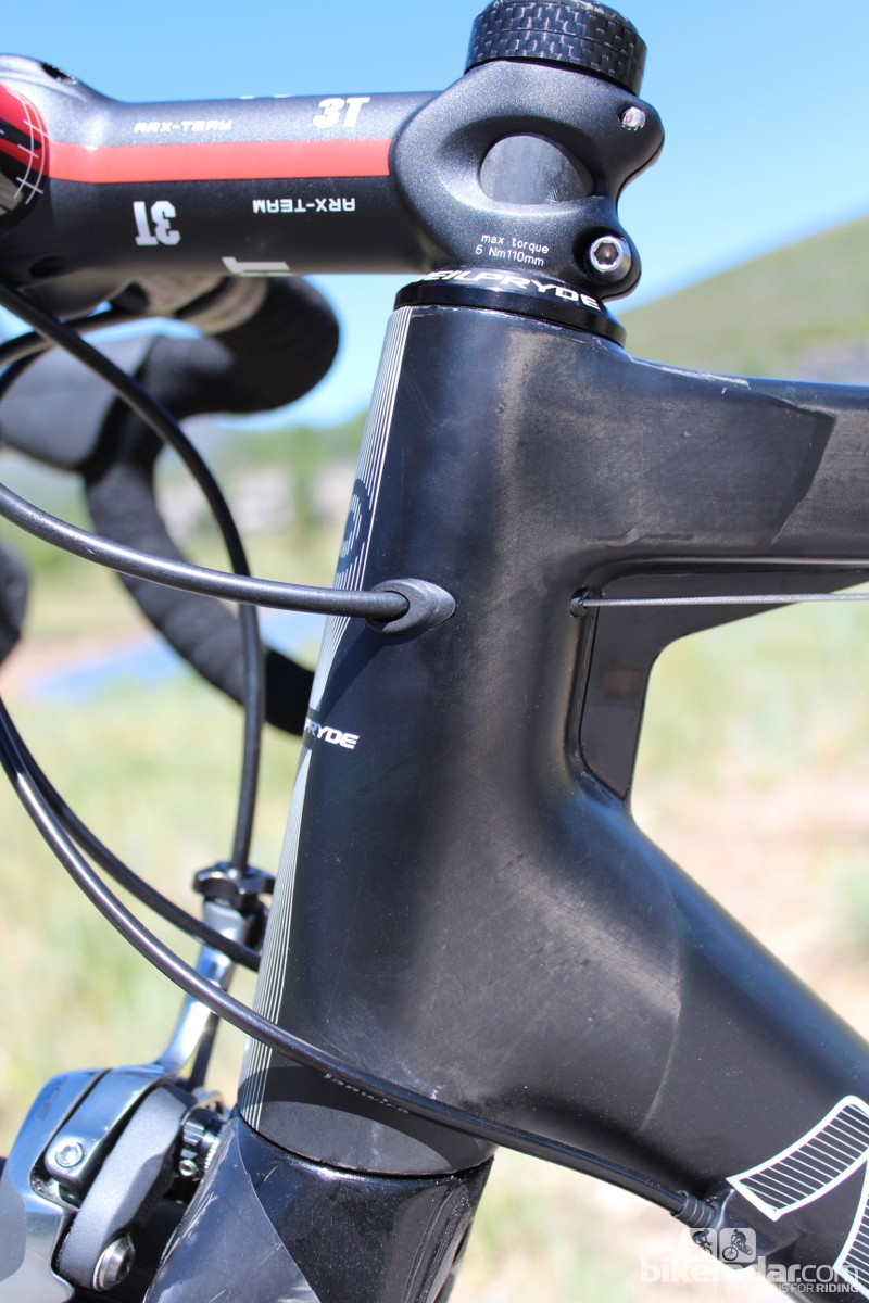 The rear brake cable exits the head tube in a unique fashion