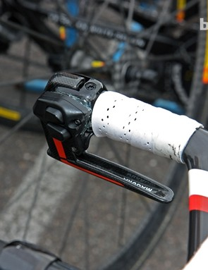 Garmin-Sharp team time trial bikes feature modified Shimano Dura-Ace Di2 shifter pods that are glued on to the Magura hydraulic brake levers