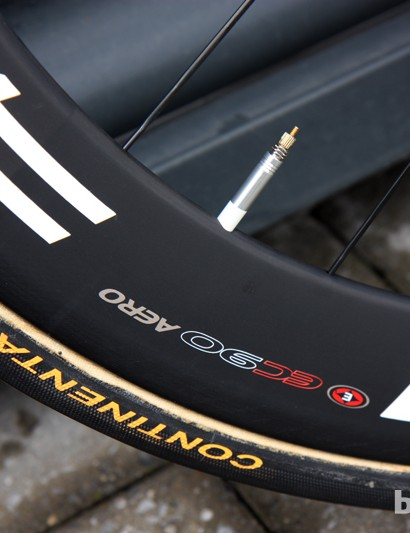 The Easton EC90 Aero carbon tubular wheels are wrapped with Continental tires