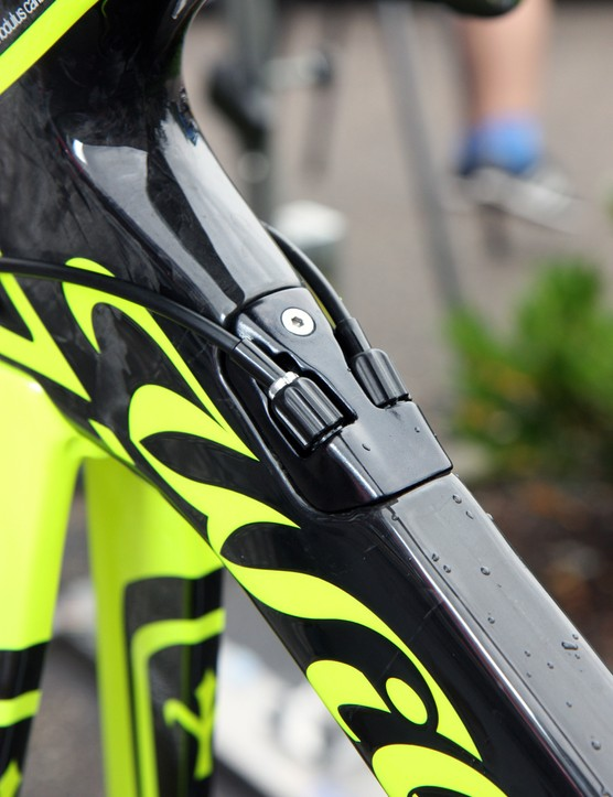 Barrel adjusters are built into the cable access port on the down tube. The removable panel should ease maintenance, and we anticipate a second version for electronic drivetrains
