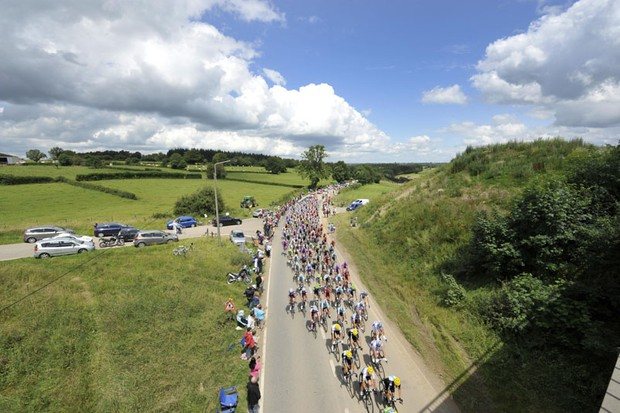 The peloton ride through the Belgian countryside during stage 1