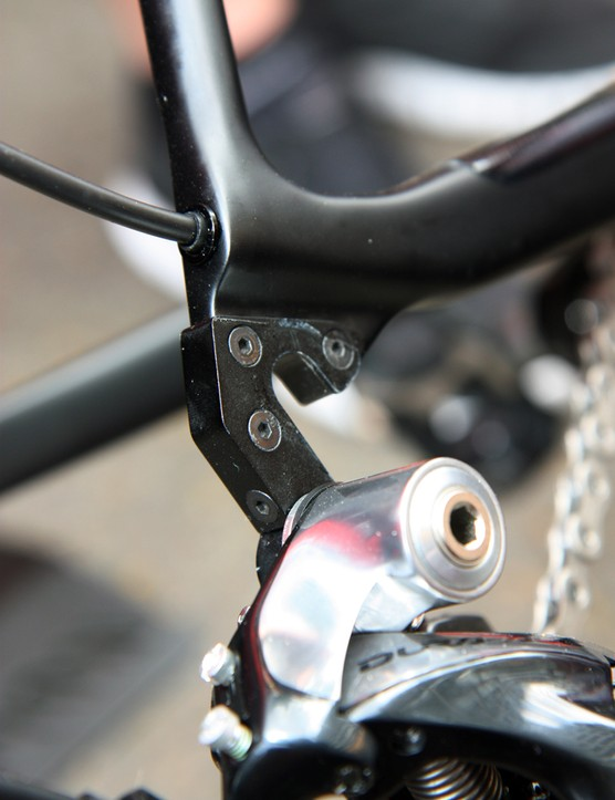 The new replaceable hanger is held together with four bolts