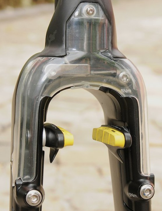 Close up of the internals of the hidden front brake and smooth inner fork crown