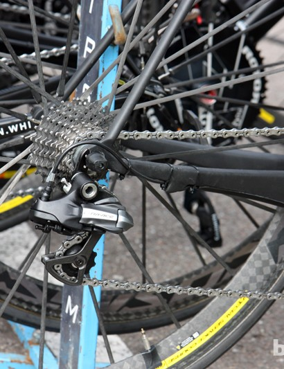 Ryder Hesjedal's ((Garmin-Sharp) Cervélo R5ca isn't designed with electronic drivetrain in mind so mechanics resort to tape and zip-ties to run the wires
