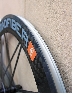 While the clincher hook and outer rim wall are aluminum, the braking surfaces are still carbon fiber and the outer appearance of the wheel is virtually identical to the tubular model