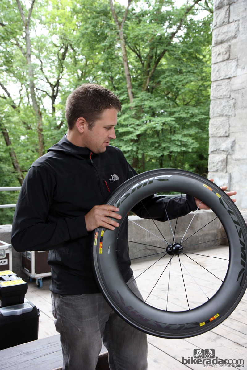 Garmin-Sharp sports scientist Robby Ketchell looks over one of the team's latest pieces of equipment, the new Mavic Cosmic CXR 80.