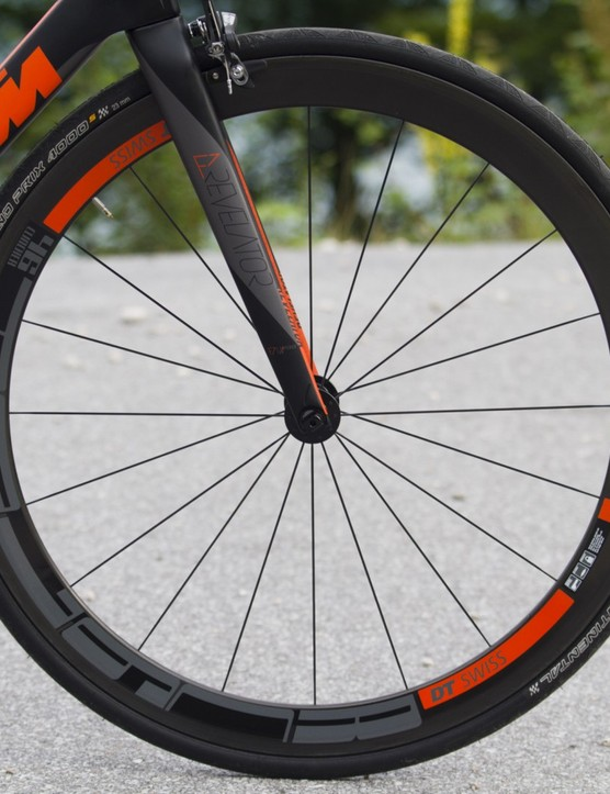 The top-end Revelator Prime sports DT Swiss carbon clinchers in KTM orange