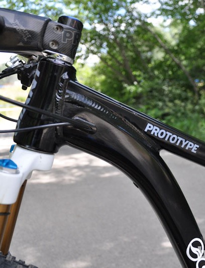 Internal routing appears to have room for two lines – in this case, the dropper post remote and rear brake