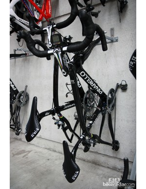 Mark Cavendish's Pinarellos stray from the stark black-and-white paint scheme only slightly, with a set of rainbow stripes around the seat stay wishbone and on the PRO stem
